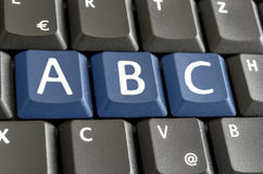 Letters A, B and C emphasized on computer keyboard. Letters A, B and C put together and  emphasized with blue keys on computer keyboard Stock Photos