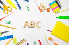 Letters A, B, C on the school desk. concept of education. back to school. stationery. White background. stickers, colored pens, pe
