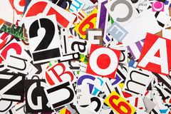 Letters background. Abstract background from newspaper letters clippings Royalty Free Stock Photo