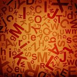 Letters background. Letters on fabric orange background Royalty Free Stock Photography