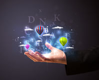 Letters and balloons in the hand of a businessman Stock Images