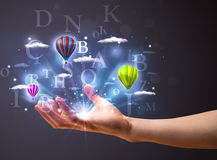 Letters and balloons in the hand of a businessman Stock Photos