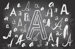 Letters A on blackboard. Vector drawing of handwritten letters A in variations of style on a black chalkboard Stock Photography
