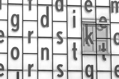 Letters on building. A building with window coated with all kinds of letters stock photography