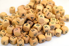 Letters. A bunch of small wooden cubes with letters Royalty Free Stock Image