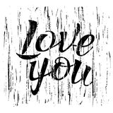 Letters calligraphy, love you, hand drawing. Letters hand drawing on brush strokes background for love themes. Word love, you. Color black, white. Happy in love Stock Photography