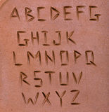 Letters carved on clay Stock Images