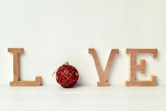 Letters and christmas bauble forming the word love Royalty Free Stock Image