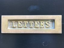 Letters. Close up of a characterful residential letterbox. Landscape orientation. Location is Cheshire, England, U.K. Taken by Matthew Oakes, August 2018 stock photography