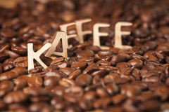 Letters on coffee beans Stock Image