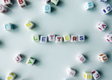 Letters - coloured cubes that spell 'letters' Stock Photo