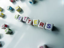 Letters - coloured cubes that spell 'letters' Royalty Free Stock Image