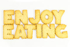 Letters Cookies. Enjoy eating  typography concept made from Cookies Royalty Free Stock Photo