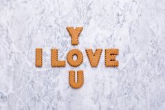 Letters cookies I Love You on marble background stock photo