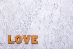 Letters tasty cookies Love on marble background stock photos