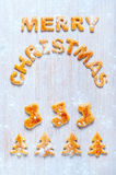 Letters of dough and Christmas cookies on the table Royalty Free Stock Image