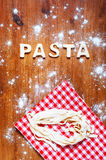 Letters of dough and pasta on the wooden table Stock Image
