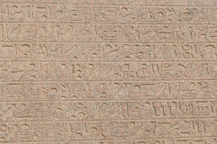Letters, drawings and signs on the walls of ancient Egyptian temple Royalty Free Stock Image