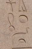 Letters, drawings and signs on the walls of ancient Egyptian temple Royalty Free Stock Images