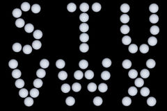 Letters drawn with golf balls. Letters S-X drawn with golf balls Royalty Free Stock Photo