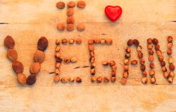 Words i love vegan with red heart royalty free stock photography