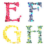 The letters E, F, G and H made of buttons Stock Image