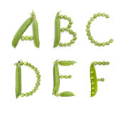 Letters of english alphabet with green peas, abc Royalty Free Stock Photos