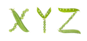 Letters of english alphabet with green peas, abc Royalty Free Stock Photo