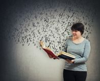 Letters escape from book stock image