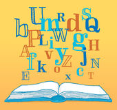Letters floating up from an open book Royalty Free Stock Photos