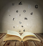 Letters flying out of the book Stock Image