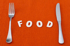 Letters food with fork and knife Stock Image