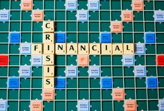 Letters forming the words Financial Crisis. Letters of a board game forming the words Financial Crisis Stock Photo