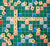 Letters forming the words Financial Crisis. Letters of a board game forming the words Financial Crisis Royalty Free Stock Photos
