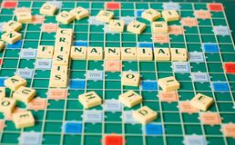 Letters forming the words Financial Crisis. Letters of a board game forming the words Financial Crisis Royalty Free Stock Images