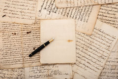 Letters and fountain pen. Fountain pen on antique letters and empty sheet royalty free stock image