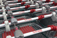 Letters geant casino on shopping carts Royalty Free Stock Image