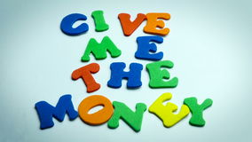 Letters Give me the money in White Background stock video footage