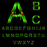 Letters of green mucus. The alphabet of green mucus with light red sore Stock Photos