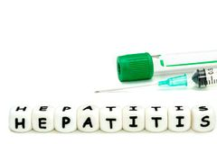 letters hepatitis, a test tube and a syringe stock images