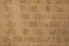 Cuneiform writing on the wall, Iran stock image