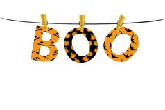 The letters and the inscription of a boo Halloween hang on pins. The letters and the inscription of a boo Halloween hang on clothespins on a rope or string Royalty Free Stock Photo