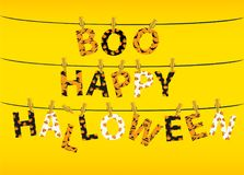 The letters and the inscription of a boo happy Halloween. The letters and the inscription of a boo happy Halloween hang on clothespins on a rope or string Royalty Free Stock Images