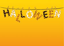 The letters and the inscription of a happy Halloween hang on clothespins. On a rope or string. Vector. Festive garland. Greeting card or invitation to a party Stock Images