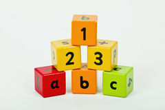 Letters  are the key  to the world of knowledge. Wooden blocks with letters and numbers stacked up Royalty Free Stock Photos