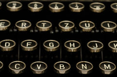Letters on a keyboard of a typewriter Royalty Free Stock Photo