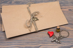 Letters kraft envelopes on wooden table. Valentine`s Day Royalty Free Stock Photos