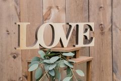 Letters of love.. Old wall or fence of wooden boards. Summer day in the park. Use for background. Wedding photo zone. Old wall or fence of wooden boards. Summer royalty free stock image