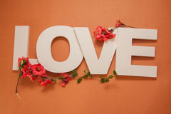 Letters love on orange background Royalty Free Stock Images