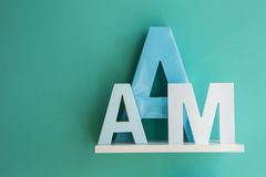 Letters A and M on a white shelf Stock Photo